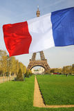 Eiffel Tower with flag of France, Paris Royalty Free Stock Photo