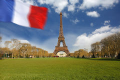 Eiffel Tower with flag of France, Paris Royalty Free Stock Photos
