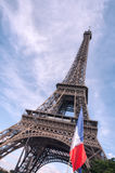 Eiffel Tower with flag of France. Paris Royalty Free Stock Photography