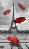 Eiffel tower with flying umbrellas. Black and white with red element Royalty Free Stock Images
