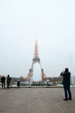 Eiffel Tower and fountains in evening fog. Stock Photography