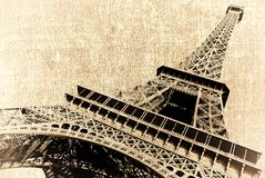 Eiffel tower. France. Paris. View of openwork Eiffel tower in style old shabby photos. Photo on canvas with lighted edges Royalty Free Stock Images