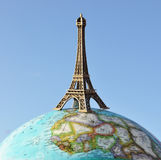 Eiffel tower. On the globe Royalty Free Stock Images