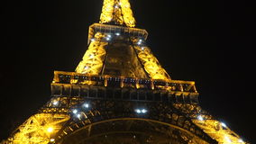The Eiffel Tower glows brightly. Brightly shines the illumination of the Eiffel Tower at night stock video footage