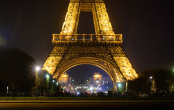 Eiffel tower with golden illumination by night in Paris Royalty Free Stock Photo