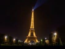 Eiffel tower with golden illumination by night in Paris Stock Photo