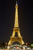 Eiffel tower with golden illumination at night in Paris Stock Images