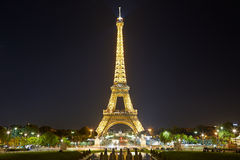 Eiffel tower with golden illumination in Paris at night Royalty Free Stock Photography