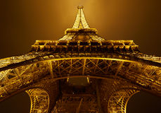 Eiffel tower, golden light in Paris at night stock image