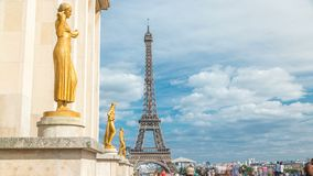 Eiffel Tower and the golden statues of women in the sun light timelapse, Trocadero square, Paris, France. Blue cloudy sky at summer day stock footage