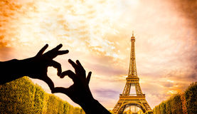 The Eiffel Tower and hands in a heart shape Royalty Free Stock Photo