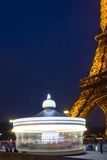 Eiffel Tower and his caroussel. The carousel (in motion) at the base of the Eiffel Tower (Paris France Stock Photos
