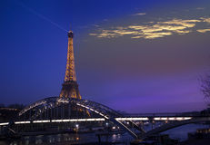 Eiffel Tower illuminated and the bridge Passerelle Debilly, view from the Seine quay in  March 17, 2012 in Paris, France. Royalty Free Stock Photo