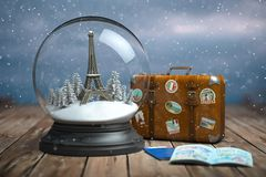 Eiffel Tower In The Snow Globe, Vintage Suitcase And Passports With Visa Stamp. Travel Or Trip To Paris And France In Winter For Stock Photography
