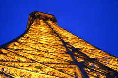 Eiffel Tower. The Eiffel Tower is an iron lattice tower located on the Champ de Mars in Paris. It was named after the engineer Gustave Eiffel, whose company Stock Image