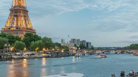 Eiffel tower and Jena bridge over Seine river day to night timelapse, Paris, France. Eiffel tower and Jena bridge over Seine river day to night transition stock footage