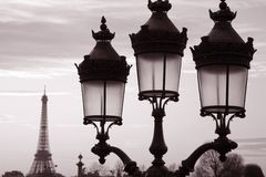Eiffel Tower and Lamppost. In Black and White Sepia Tone, Paris, France royalty free stock image