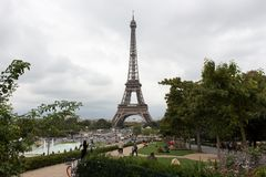 Eiffel tower landscape in a cloudy day royalty free stock images
