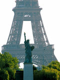 The Eiffel Tower and Liberty statue replica, Paris. Two major works of Gustave Eiffel, photographed in perspective from the Seine dockside in Paris, France Royalty Free Stock Photos
