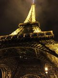 Eiffel Tower lighted Stock Images