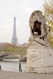 Eiffel Tower and Lion Statue Stock Photo