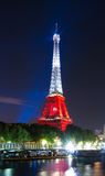 The Eiffel tower lit up in color of Poland's flag  at night, Par Stock Photo