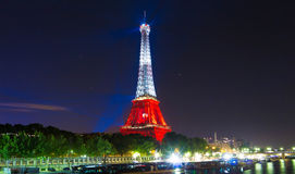 The Eiffel tower lit up in color of Poland's flag  at night, Par Royalty Free Stock Photography
