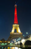 The Eiffel tower lit up with the colors of Belgian National flag Royalty Free Stock Photography
