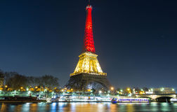 The Eiffel tower lit up with the colors of Belgian National flag Stock Images