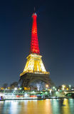 The Eiffel tower lit up with the colors of Belgian National flag Royalty Free Stock Image