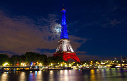 The Eiffel tower lit up with the colors of French national flag. Stock Images