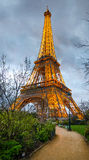 The Eiffel Tower Lit Up At Night From The Champ De Mars Park Stock Photography