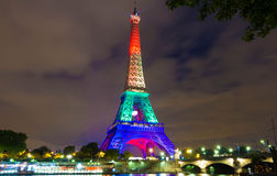 The Eiffel tower lit up with rainbow colors, Paris, France. Paris; France-June 13, 2016 : The Eiffel tower lit up in colors of the  rainbow flag in solidarity Stock Photo