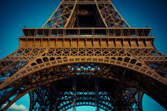 Eiffel tower in low angle view, during summer in Paris, France. Stock Photo