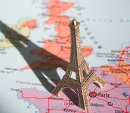 Eiffel Tower on the map. A souvenir Eiffel Tower on a map of France with long shadow Stock Photo
