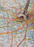 Eiffel Tower on a map of Paris. Short focus Stock Photography