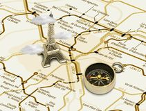 Eiffel tower on a map of Paris. Eiffel tower and compass on a map of Paris Royalty Free Stock Photography
