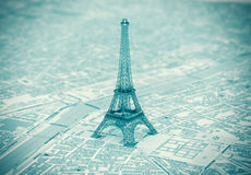 Eiffel Tower on the map of Paris. Extreme closeup Royalty Free Stock Image