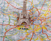 Eiffel Tower on a map of Paris, Stock Images
