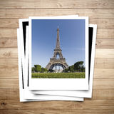 Eiffel Tower memory on photo frame. Brown wood plank background Stock Photography