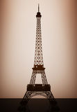 Eiffel Tower Model with backlight over Wall. 3d Rendering Stock Images