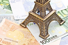 Eiffel tower model on Euro banknotes. Bronze Eiffel tower model placed on Euro banknotes Stock Photos