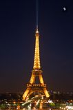 The Eiffel Tower and moon. Paris, the eiffel with the cold moon Royalty Free Stock Photography