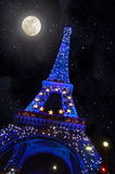 The Eiffel tower in the moonlight Stock Images
