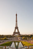 Eiffel tower in the morning. Eiffel tower seen from Trocadero with a partial reflection in water royalty free stock image