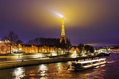 The Eiffel tower and river Seine – PARIS,  DECEMBER 22, 2017. The Eiffel tower is the most visited monument of France  and one of the most recognisable Stock Photos