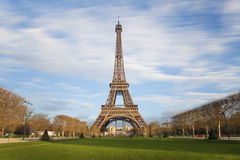 Eiffel tower with moving clouds on blue sky in Paris Royalty Free Stock Photos