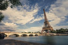 Eiffel tower near the Seine river, Paris symbol and iconic landmark in France, on a bright sunny day. Famous touristic Royalty Free Stock Photo
