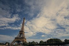 Eiffel tower near the Seine river, Paris symbol and iconic landmark in France, on a bright sunny day. Famous touristic Royalty Free Stock Images