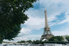 Eiffel tower near the Seine river, Paris symbol and iconic landmark in France, on a bright sunny day. Famous touristic. Places and romantic travel destinations Stock Images